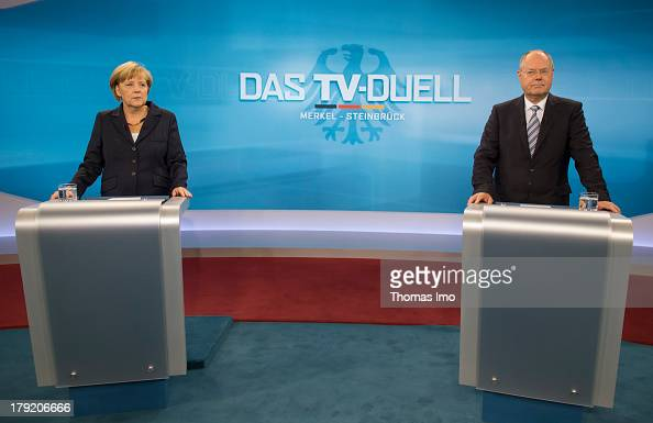 The Social Democratic Party's main candidate in upcoming parliamentary elections Peer Steinbrueck and German Chancellor Angela Merkel poses for a...