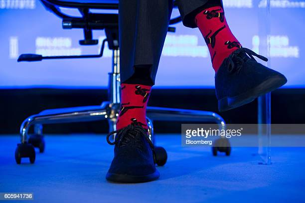 The socks of David Bonderman cofounder and chairman of TPG Holdings LP are seen as he speaks at the Milken Institute Asia Summit in Singapore on...