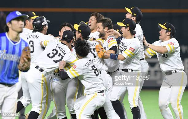 The SoftBank Hawks celebrate their eighth Japan Series title after beating the DeNA BayStars 43 in 11 innings in Game 6 at Yafuoku Dome in Fukuoka on...