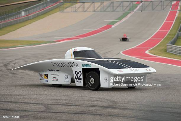 The solar car from Principia College of Elsah Illinois rounds turn 12 during qualifying races for the 1700mile American Solar Challenge race at...