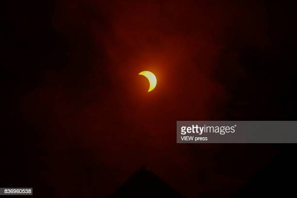 The solar eclipse in front of the skyline of Manhattan as is seen from Hoboken New Jersey on August 212017