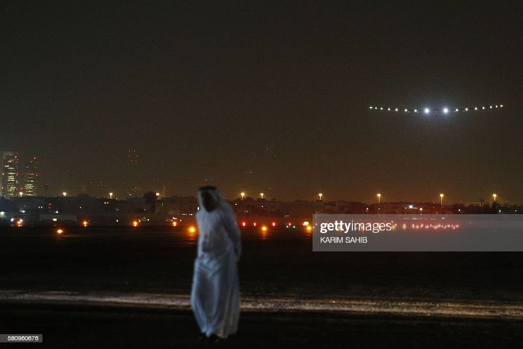 TOPSHOT The Solar Impulse 2 aircraft piloted by Bertrand Piccard makes its final approach for landing at Al Batin Airport in Abu Dhabi to complete...