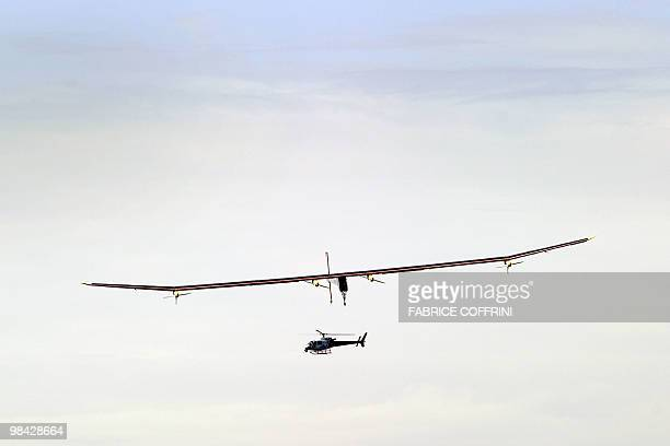 The Solar Impulse aircraft a pioneering Swiss bid to fly around the world on solar energy glides prior to landing after it first test flight on April...