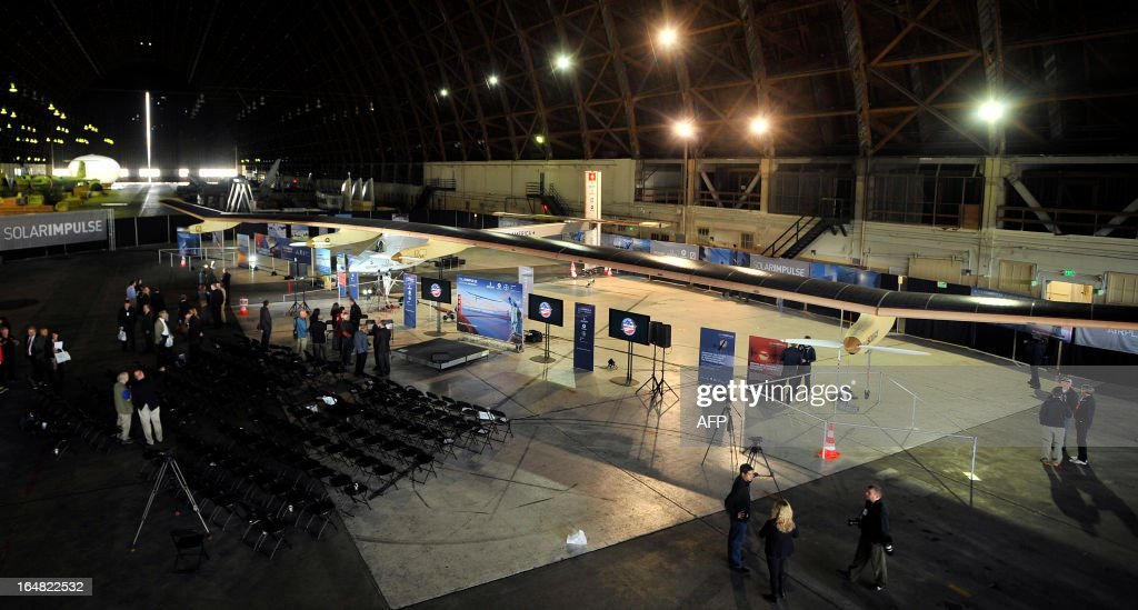The Solar Impulse solar plane is seen at a press conference at the NASA Ames Research Center in Mountain View, California on Thursday, March 28, 2013. The Solar Impulse project aims to fly an aircraft around the world using only solar energy. AFP PHOTO/Josh Edelson