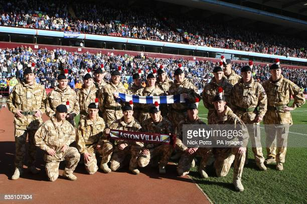 The soldiers of the 1st Battalion the Royal Regiment of Fusiliers recently home from Iraq line up on the pitch at half time