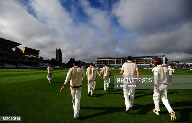 The Somerset side make their way out for the start during Day Four of the Specsavers County Championship Division One match between Somerset and...
