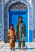 The son and father at tomb of Hazrat Shah Abdul Lt