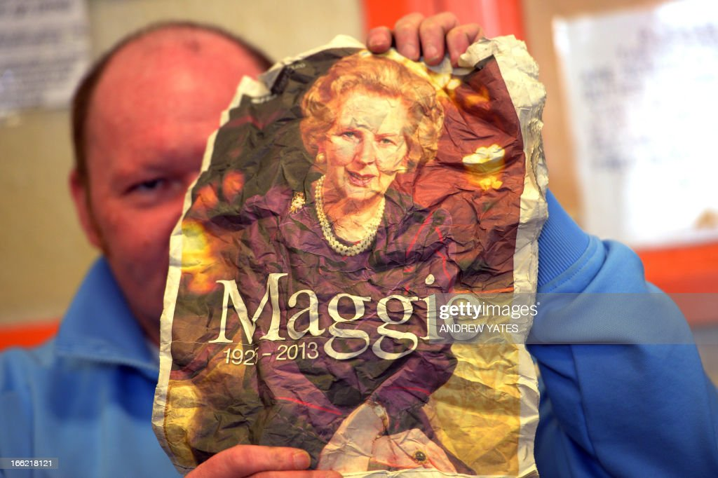 The son of a coal miner holds up a screwed-up portrait of British former prime minister Margaret Thatcher from a newspaper report on her death at the Armthorpe Social Club in Doncaster, northern England, on April 9, 2013. Mention the death of Margaret Thatcher in one of the 'working men's clubs' frequented by former coal miners in northern England, and you will be met with roars of approval. It has been 28 years since her Conservative government crushed the miners' year-long strike, ending one of the most bitter industrial battles in British history.