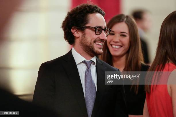 The son of French President Thomas Hollande is pictured with his girlfriend Emilie Broussouloux during a state dinner at the Elysee Palace in Paris...
