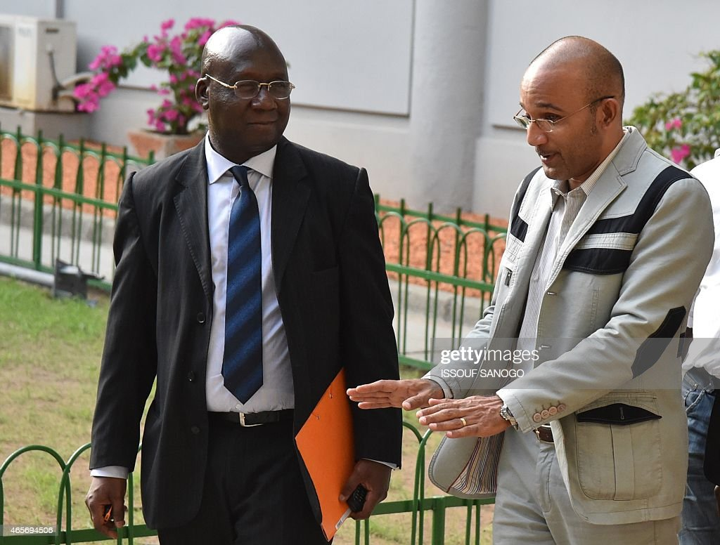 The son of Ivory Coast's former President Laurent Gbagbo, Michel Gbagbo (R), and former Ivorian Foreign Minister Alcide Djedje (L) arrive at the Court of Justice in Abidjan, on March 9, 2015, to attend a hearing in their trial on charges of 'attempting to undermine the security of the state' in events leading to a bloody 2010-2011 post electoral crisis that left thousands dead. Eighty-three people, including former first lady Simone Gbagbo, standing trial. Gbagbo's husband, former president Laurent Gbagbo, who is currently in custody in the Hague, faces four counts of crimes against humanity.