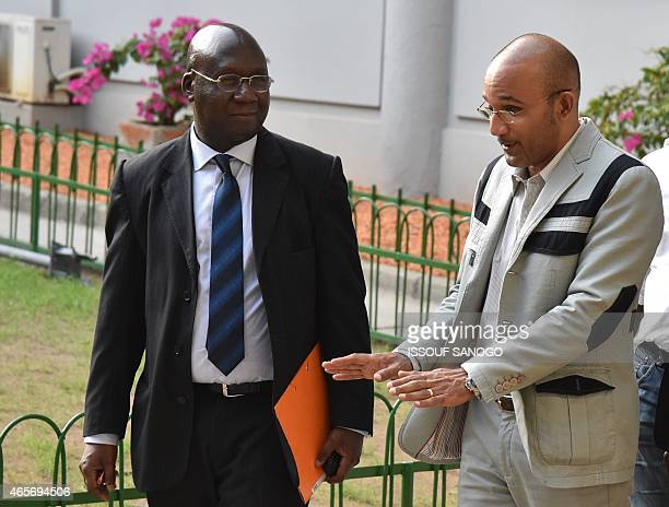 The son of Ivory Coast's former President Laurent Gbagbo Michel Gbagbo and former Ivorian Foreign Minister Alcide Djedje arrive at the Court of...