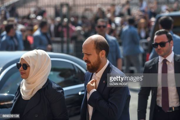 The son of the Turkish president Bilal Erdogan and his wife arrive at a polling station to cast their vote in the referendum on expanding the powers...