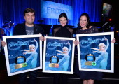 The songwriters and performer of Disney's 'Frozen' were presented with gold records commemorating the Oscar®nominated single 'Let It Go' from the...