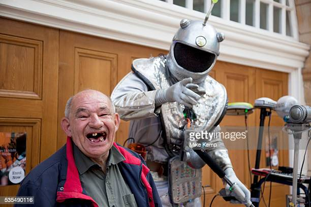 The Sonic Manipulator a busker / street performer performing his electronic music show to a toothless man who decided to join in the fun much to the...