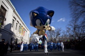 The Sonic the Hedgehog balloon floats above the street during the Macy's Thanksgiving Day Parade on November 28 2013 in New York City Despite earlier...