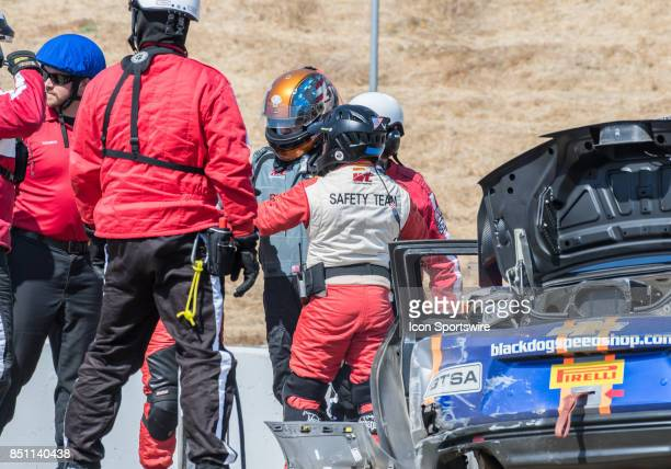 The Sonoma Track Safety Team check out Tony Gaples Blackdog Speed Shop after his accident in the Chevrolet Camaro GT4 during the World Challenge GTS...