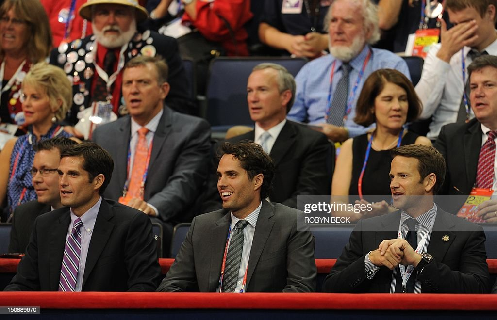 The sons of Mitt Romney (from L-R) Matt, Craig and Josh, are seen in the bleachers at the Tampa Bay Times Forum in Tampa, Florida, on August 28, 2012 during the Republican National Convention. The 2012 Republican National Convention is expected to host 2,286 delegates and 2,125 alternate delegates from all 50 states, the District of Columbia and five territories. AFP PHOTO Robyn BECK