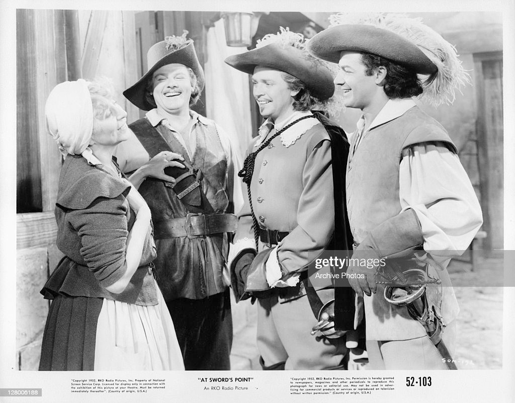 The sons of the Three Muskateers, from second left, Alan Hale Jr, Dan O'Herlihy, and <a gi-track='captionPersonalityLinkClicked' href=/galleries/search?phrase=Cornel+Wilde&family=editorial&specificpeople=227460 ng-click='$event.stopPropagation()'>Cornel Wilde</a>, laugh with a woman in a scene from the film 'At Sword's Point', 1952.
