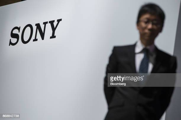 The Sony Corp logo is displayed on stage during a news conference in Tokyo Japan on Wednesday Nov 1 2017 The AIenabled canine 'aibo' comes equipped...