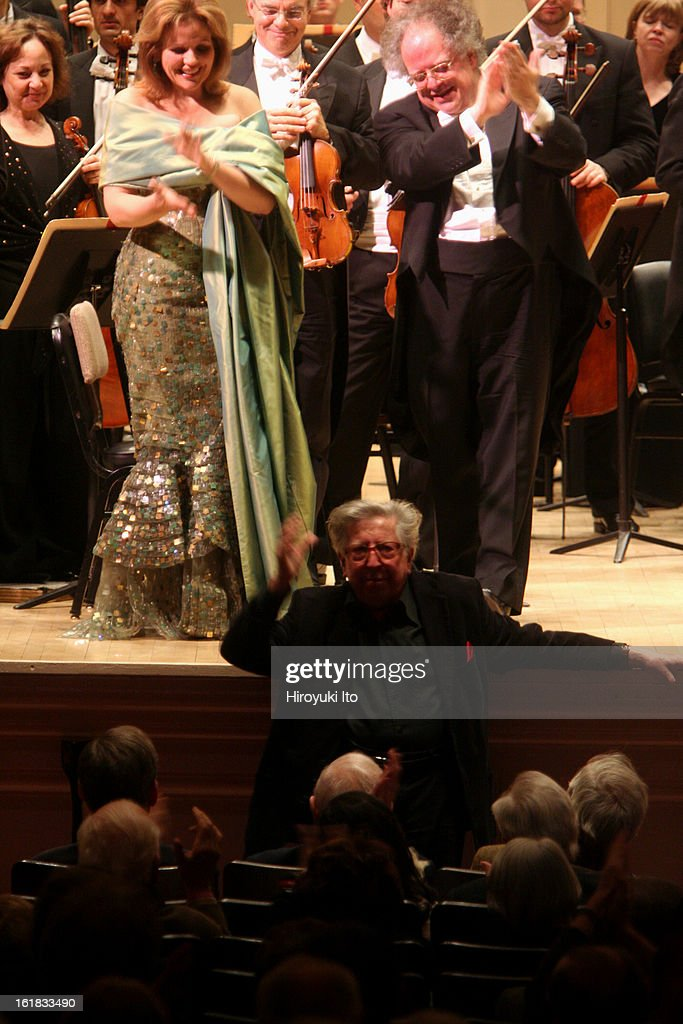 The soprano Renee Fleming performing Henri Dutilleux's 'Le Temps l'Horloge' with the Boston Symphony Orchestra led by <a gi-track='captionPersonalityLinkClicked' href=/galleries/search?phrase=James+Levine+-+Conductor&family=editorial&specificpeople=220716 ng-click='$event.stopPropagation()'>James Levine</a> at Carnegie Hall on Monday night, December 3, 2007.This image;The composer Henri Dutilleux in the audience with Renee Fleming and <a gi-track='captionPersonalityLinkClicked' href=/galleries/search?phrase=James+Levine+-+Conductor&family=editorial&specificpeople=220716 ng-click='$event.stopPropagation()'>James Levine</a> on stage after Mr. Levine led the Boston Symphony Orchestra in Mr. Dutilleux's 'Le Temps l'Horloge' with Ms. Fleming as soloist.