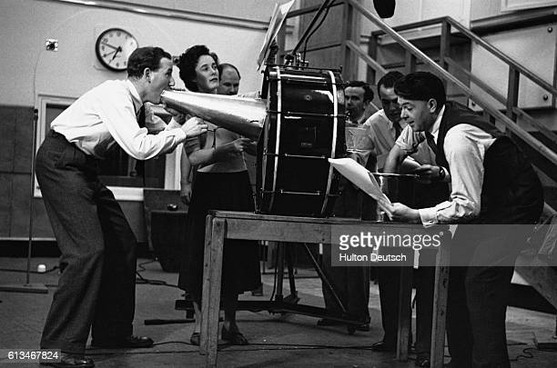 The sound effects team of the BBC radio drama department produces effects for the broadcast of the serial of H G Wells's War of the Worlds The sounds...