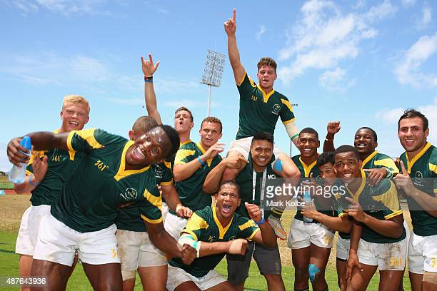 The South Africa boys rugby sevens team celebrate after defeating Australia in the boys rugby sevens final at the Apia Park Sports Complex on day...