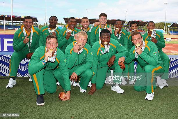 The South Africa boys rugby sevens team pose with their gold medals after defeating Australia in the boys rugby sevens final at the Apia Park Sports...