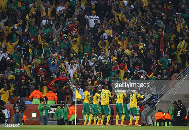 The South Africa players celebrate scoring the first goal during the 2010 FIFA World Cup South Africa Group A match between South Africa and Mexico...