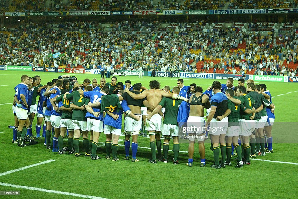 The South African and Samoan teams gather for prayer after the final whistle in the Rugby World Cup Pool C match between South Africa and Samoa on...