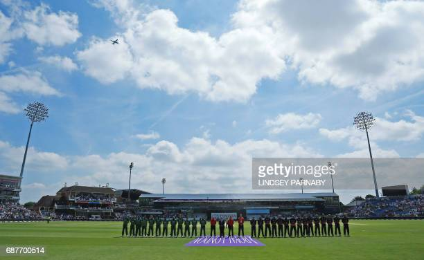 CORRECTION The South African and the England teams observe a minute's silence at the start of the first OneDay International between England and...