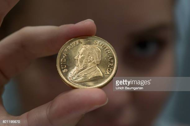 The South African Krugerrand the most famous gold coin in the world celebrates its 50th anniversary in 2017 The photo shows a young woman with a...