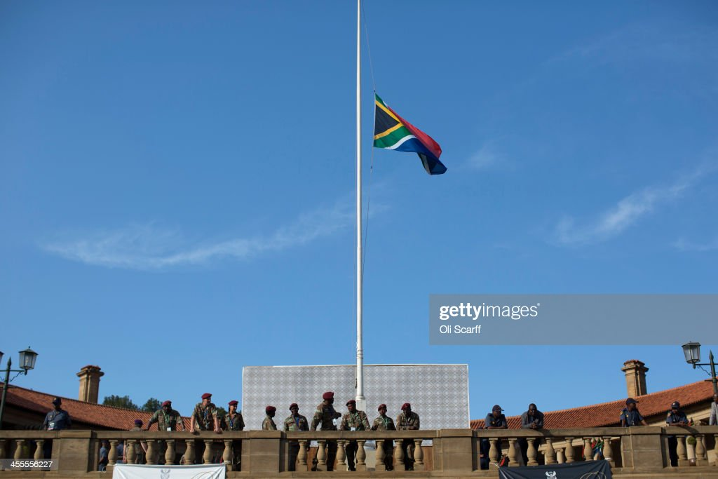 The South African national flag flies at half-mast outside the Union Buildings where the body of anti-apartheid hero, former South African president Nelson Mandela, is laying in state for three days on December 12, 2013 in Pretoria, South Africa. Over 60 heads of state have travelled to South Africa to attend a week of events commemorating the life of former South African President Nelson Mandela. Mr Mandela passed away on the evening of December 5, 2013 at his home in Houghton at the age of 95. Mandela became South Africa's first black president in 1994 after spending 27 years in jail for his activism against apartheid in a racially-divided South Africa.