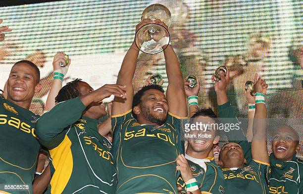 The South African team celebrate after winning the Cup Final during day three of the IRB Adelaide International Rugby Sevens match between South...
