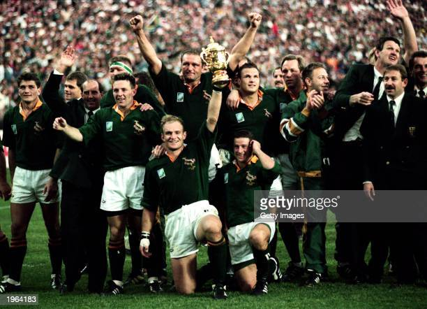 The South African Team celebrate after winning the Rugby World Cup final between South Africa and New Zealand held on June 24 1995 at Ellis Park in...