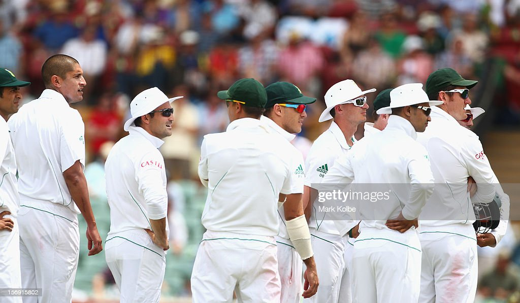 The South African team watch the big screen as they wait for a third umpire decision during day four of the Second Test Match between Australia and South Africa at Adelaide Oval on November 25, 2012 in Adelaide, Australia.