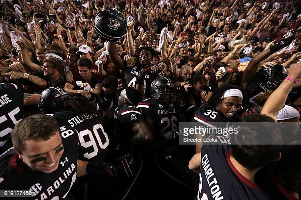 The South Carolina Gamecocks celebrate after defeating the Tennessee Volunteers 2421 in their game at WilliamsBrice Stadium on October 29 2016 in...