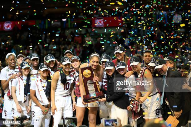 The South Carolina Gamecocks celebrate with the NCAA trophy after winning the championship game against the Mississippi State Lady Bulldogs of the...