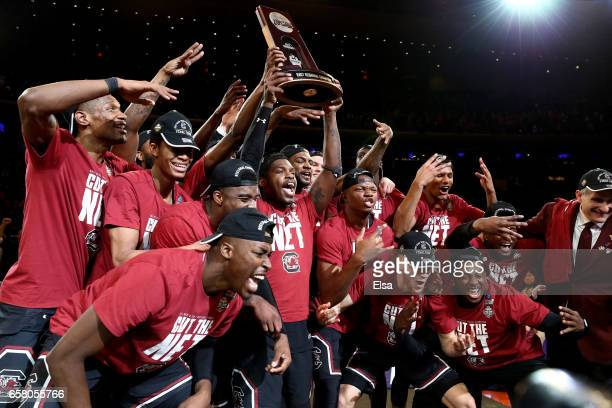 The South Carolina Gamecocks celebrate with the their trophy after defeating the Florida Gators with a score of 77 to 70 to win the 2017 NCAA Men's...
