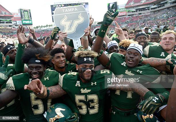 The South Florida Bulls celebrate their win over the UCF Knights at Raymond James Stadium on November 26 2016 in Tampa Florida