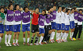 The South Korea team celebrates after a draw gives them victory and progress to round two in the 2010 FIFA World Cup South Africa Group B match...