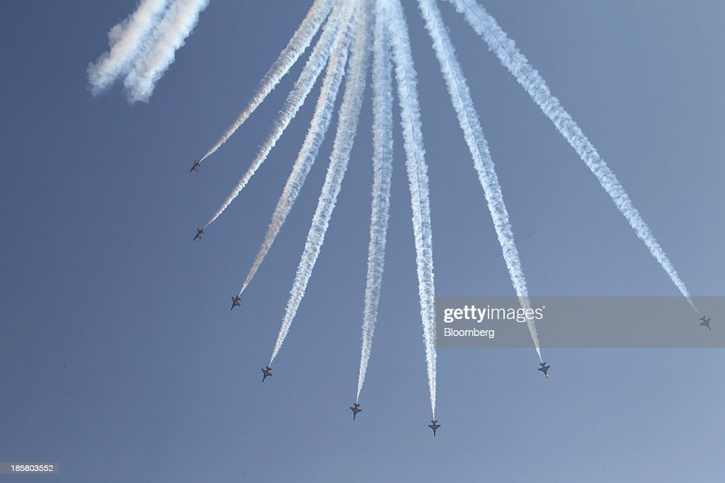 The South Korean Air Force Black Eagle aerobatics team performs maneuvers during the Cheongju International Airport Air Show on the sidelines of the Seoul International Aerospace & Defense Exhibition 2013 at Cheongju International Airport in Cheongju, South Korea, on Friday, Oct. 25, 2013. The exhibition will run till Nov. 3. Photographer: SeongJoon Cho/Bloomberg via Getty Images
