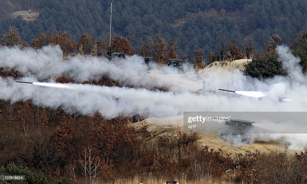 The South Korean Army K136 Kooryong 130mm 36round multiple rocket launch system fires rounds during air and ground military exercises on the Seungjin...