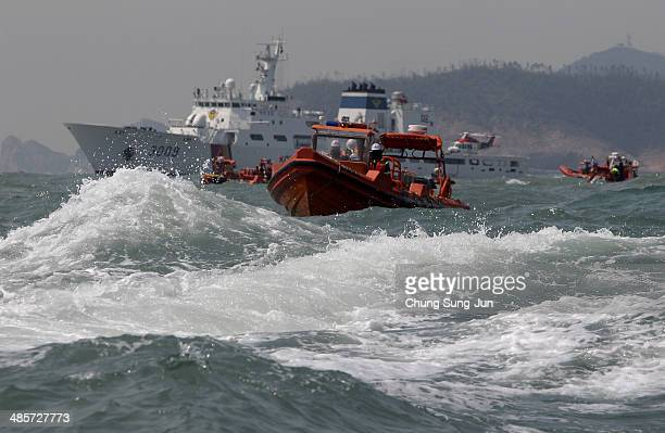 The South Korean coast guard searches for missing passengers at the site of the sunken ferry off the coast of Jindo Island on April 20 2014 in...