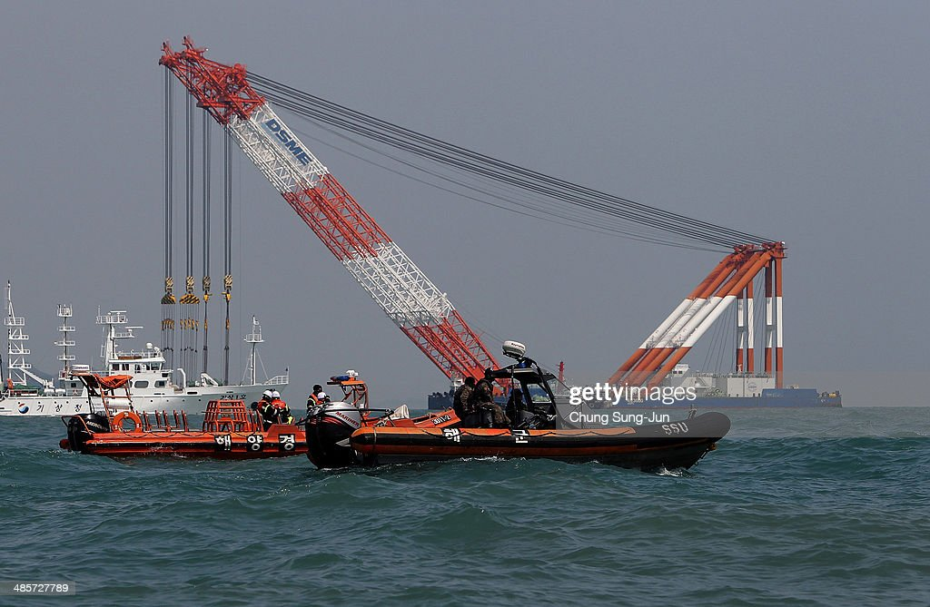 The South Korean coast guard searches for missing passengers at the site of the sunken ferry off the coast of Jindo Island on April 20, 2014 in Jindo-gun, South Korea. At least fifty six people are reported dead, with 246 still missing. The ferry identified as the Sewol was carrying about 470 passengers, including the students and teachers, traveling to Jeju Island.