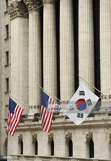 The South Korean flag flies with US flags outside the New York Stock Exchange before South Korea's Ambassador to the US Ahn HoYoung rang the opening...