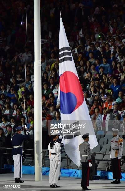 The South Korean flag is hoisted during the opening ceremony of the 2014 Asian Games at the Incheon Asiad Main Stadium in Incheon on September 19...