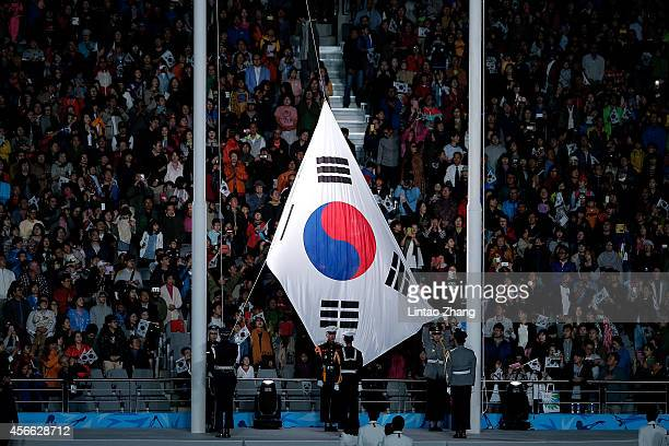 The South Korean flag is raised during the closing ceremony of the 2014 Asian Games at The Incheon Asiad Main Stadium on October 4 2014 in Incheon...