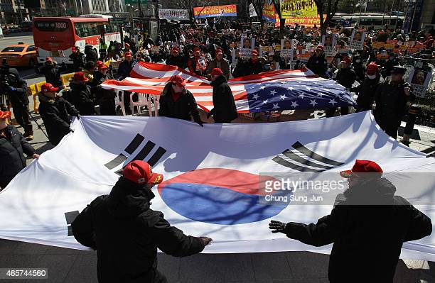 The South Korean flag is waved as South Korean conservative protesters participate in a rally denouncing the attack on US Ambassador to South Korea...