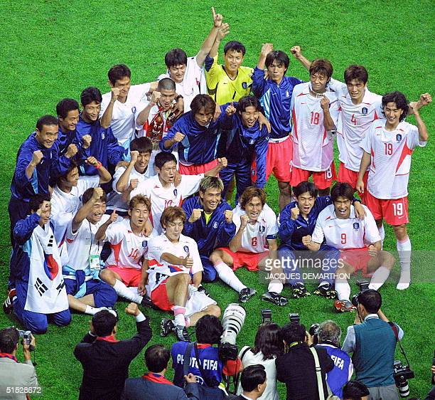 The South Korean team pose for photographers following their win over Italy in their second round match at the 2002 FIFA World Cup Korea/Japan in...