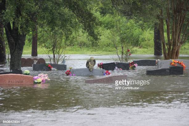 The South Park Cemetery in Pearland Texas is flooded by rains from Hurricane Harvey on August 29 2017 Damage from Hurricane Harvey could put it among...